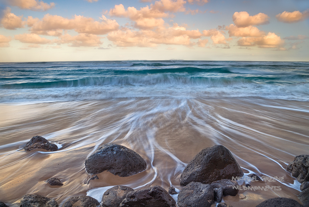 Tide lines show off the surf andsunrise near the northern end of PolihaleState Park. This beachis a 75...