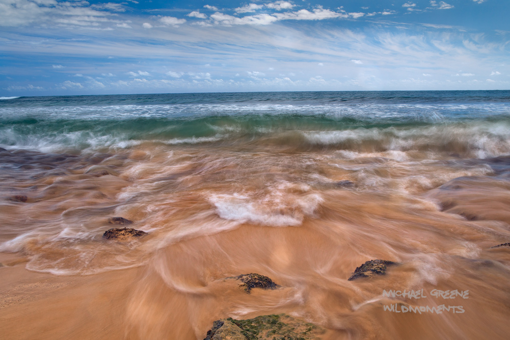 Incoming and outgoing tidal patterns of the Pacific Ocean intersect at a remote section of shoreline near Poipu Beach, Hawaii...