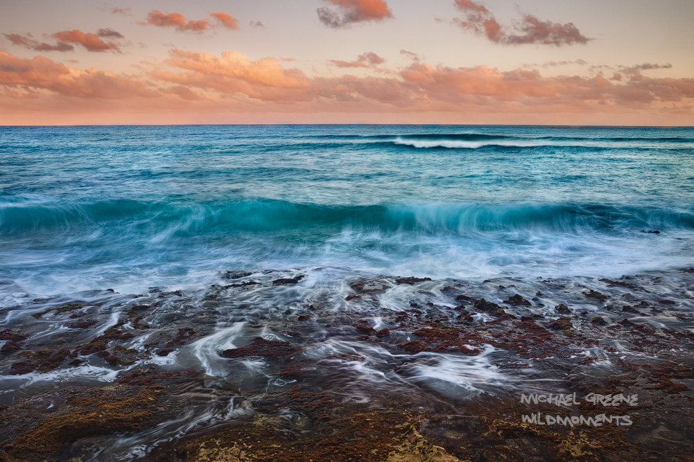 I enjoyed timing the sunsetwaves splashing over tide pools in this intimate cove near Lihue, Hawaii.I discovered...