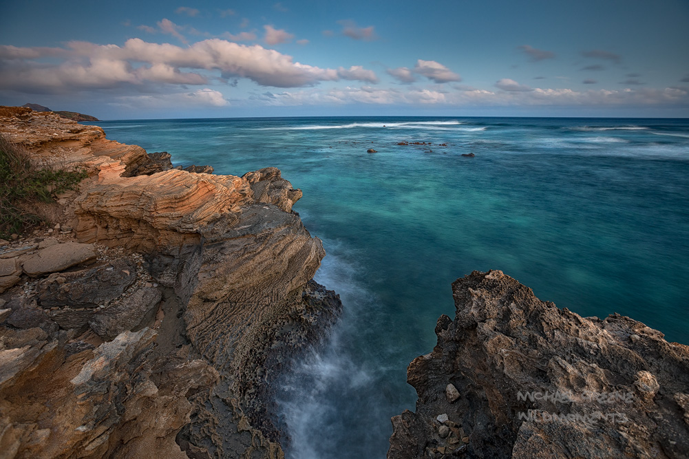 Blue Hour brings out the ocean's subtle colorsas seen from sandstone cliffs on the south side of the island.