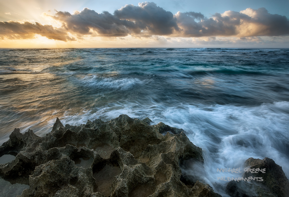 A mostly inaccessible stretch of sandstone shoreline made for an appealing sunrisenear Poipu Beach, Hawaii.
