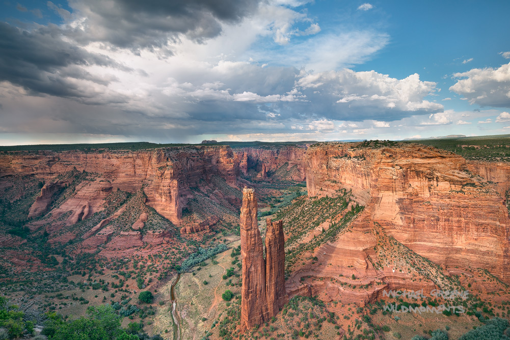 Dramatic afternoonthunderstorms illuminate Spider Rock in a remote corner of the park. Canyon De Chelley is located near...