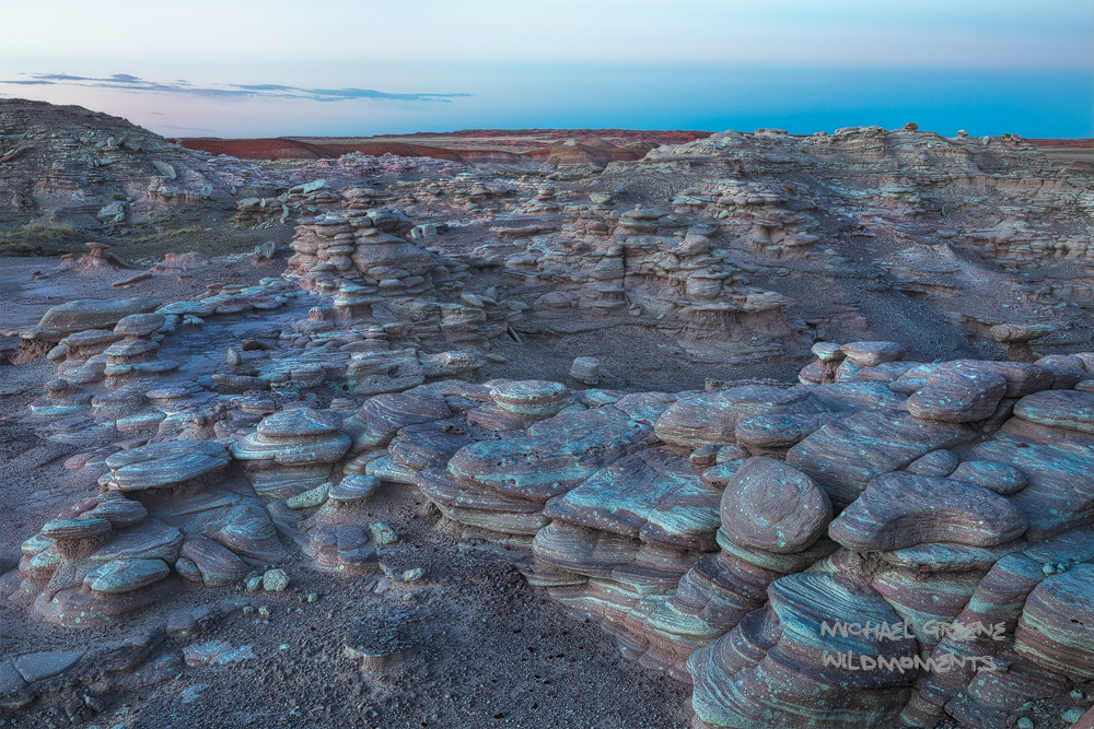 Blue hour vistas of the painted desert from a rocky perch in the Petrified Forest. This national park is located near Holbrook...