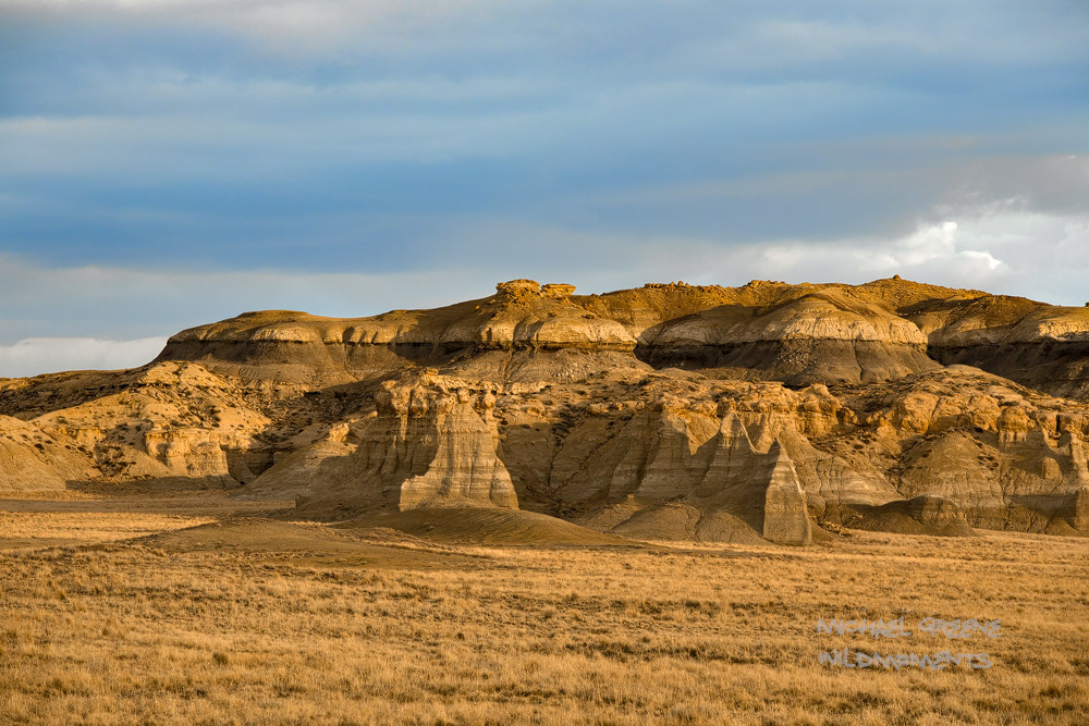 Dappled storm light highlights the the colorful and unique palettes of New Mexico's famous San Juan badlands.