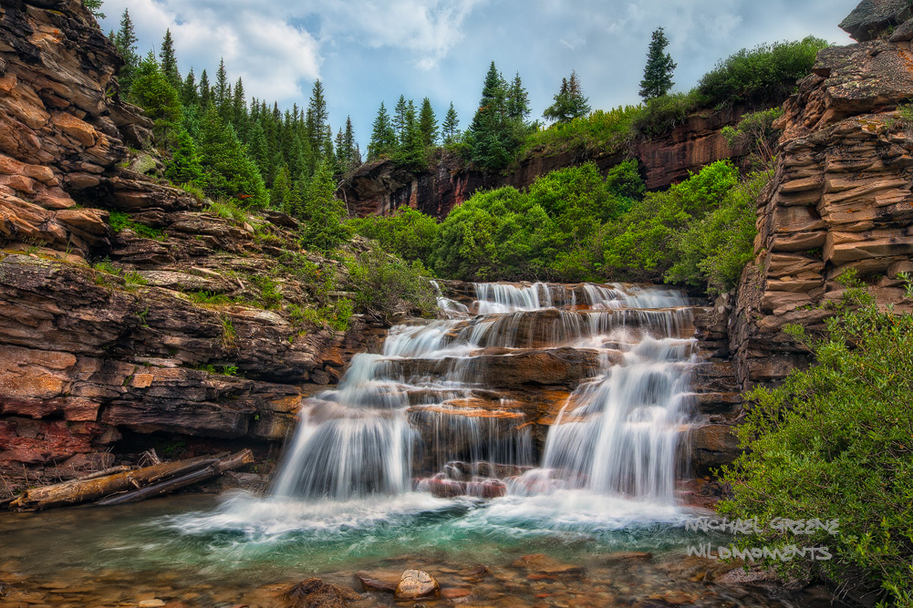 A stunning waterfall in a hidden gorge near Ouray, Colorado captured on a stormy, summer evening.