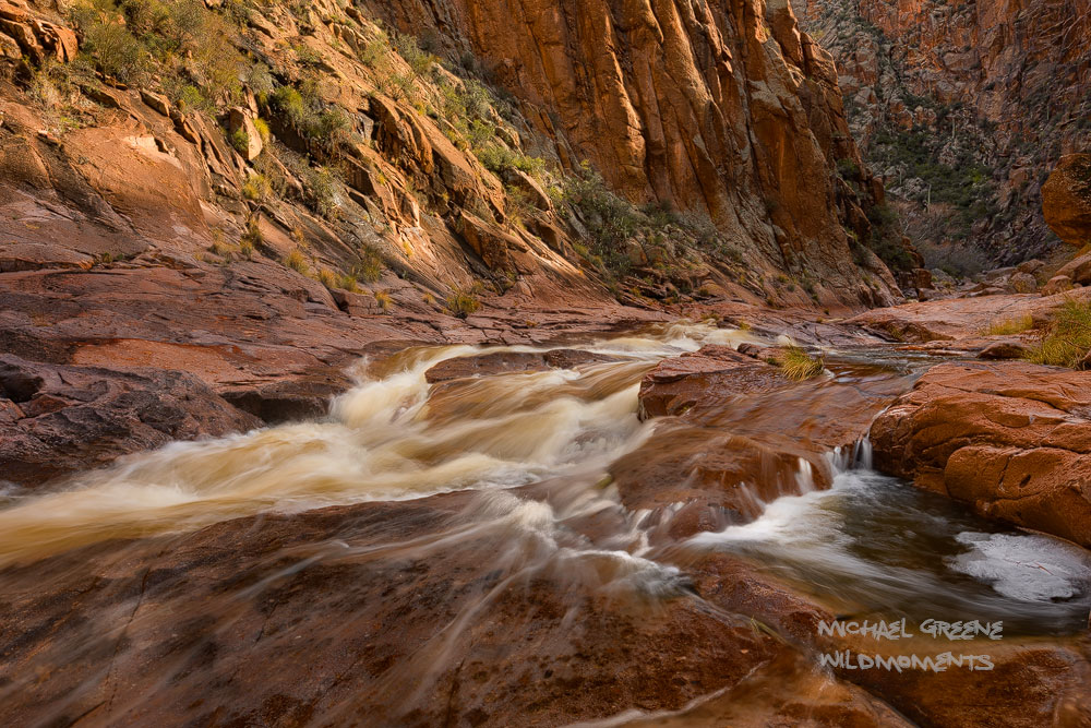 A temporary river rages through a slot canyon in the backcountry of the Superstition Mountains after a series of winter storms...
