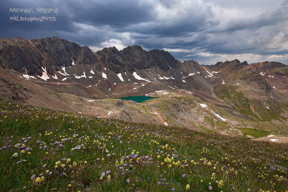 I used colorful paintbrush and asters to fill the foreground of this perch just above Sloan Lake in American Basin. This area...