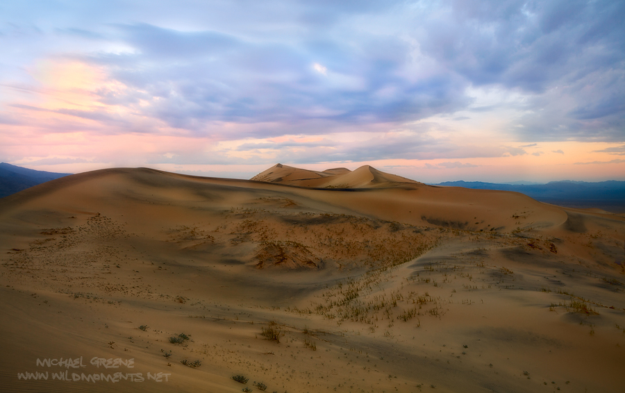 A stormy sunrise atop the Kelso Dunes in the Southeastern portion of the Mohave National Preserve in California. These sand dunes...