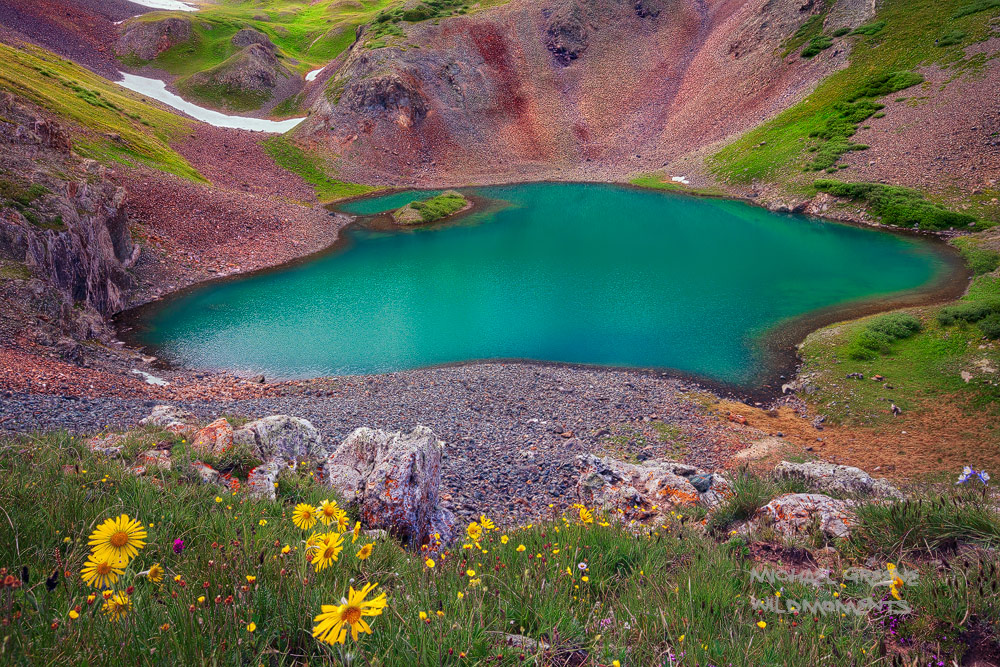 Overlooking Hematite Lake from a treacherous perch. This lake is reached via a difficult hike outside the mountain town of Silverton...