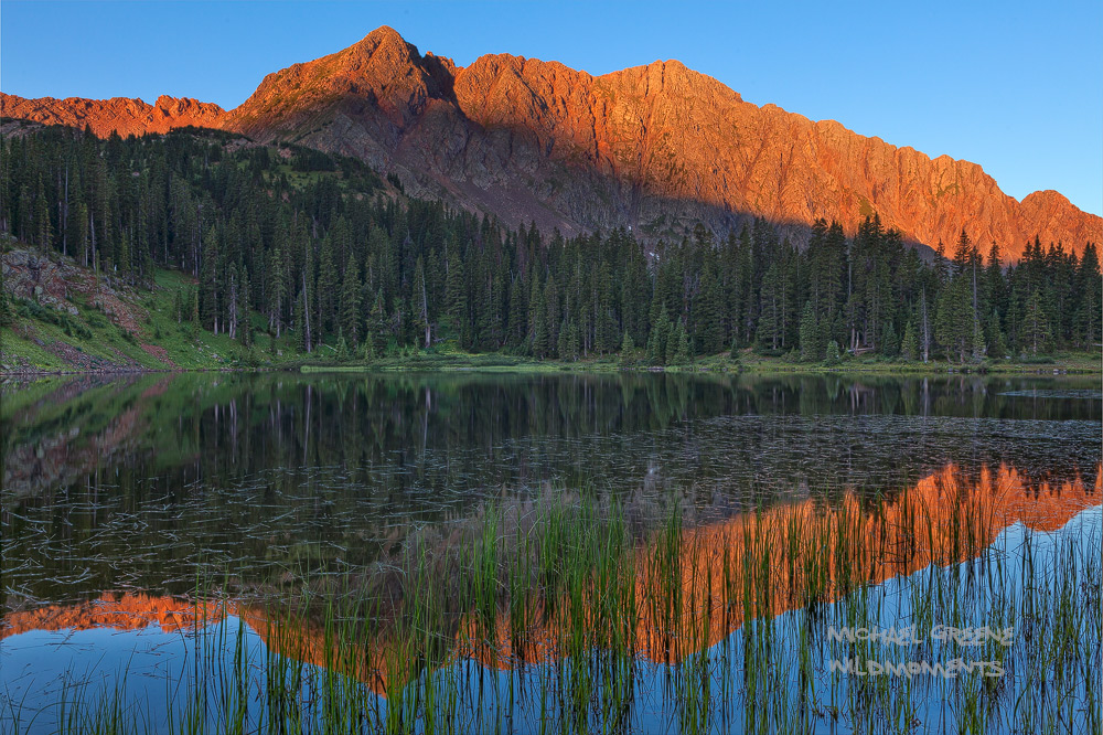 Sunrise alpenglow from the marshy banks of Crater Lake in the Weminuche Wilderness. Find more information for this location in...