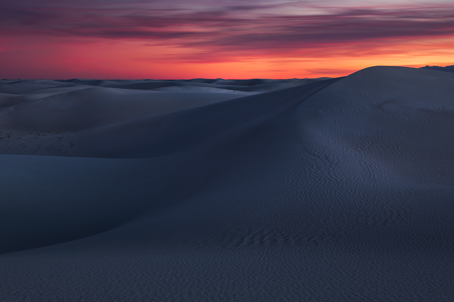 A long exposure of an eerie yet colorful sunset as seen in the backcountry of White Sands National Monument. These sand dunes...