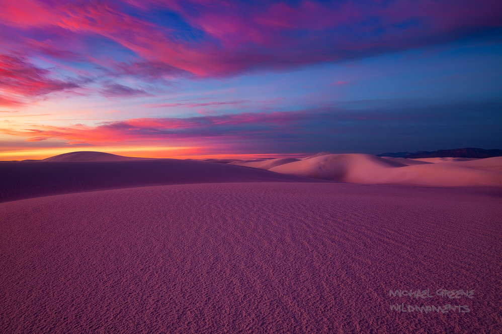 This image features peak colors of a fantastic sunrise during a full moon set in the backcountry of White Sands National Monument...