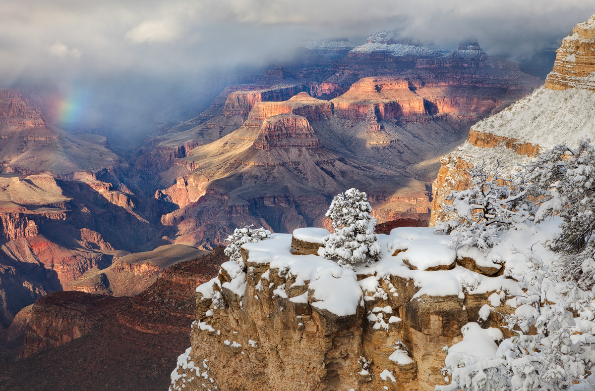 A rare glimpse of a rainbow during a late winter snowstorm in the Grand Canyon National Park, Arizona.