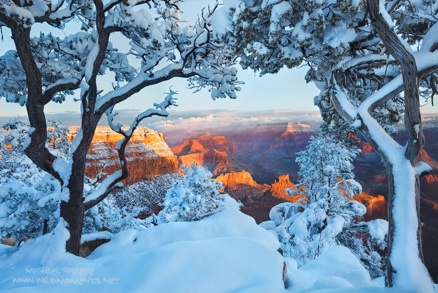 Sunshine and lingering clouds accentuated the splendid scenery during sunrise at Grand Canyon NP after a winter snowstorm.
