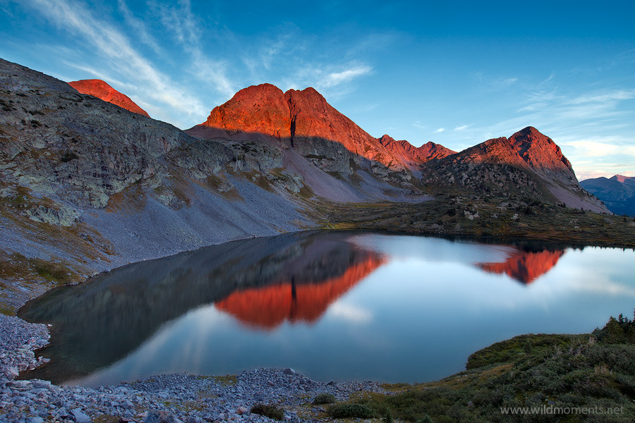 Alpenglow captured from a vista above the massive cirque that forms Rock Lake (11,841 ft) deep within the boundaries of the San...