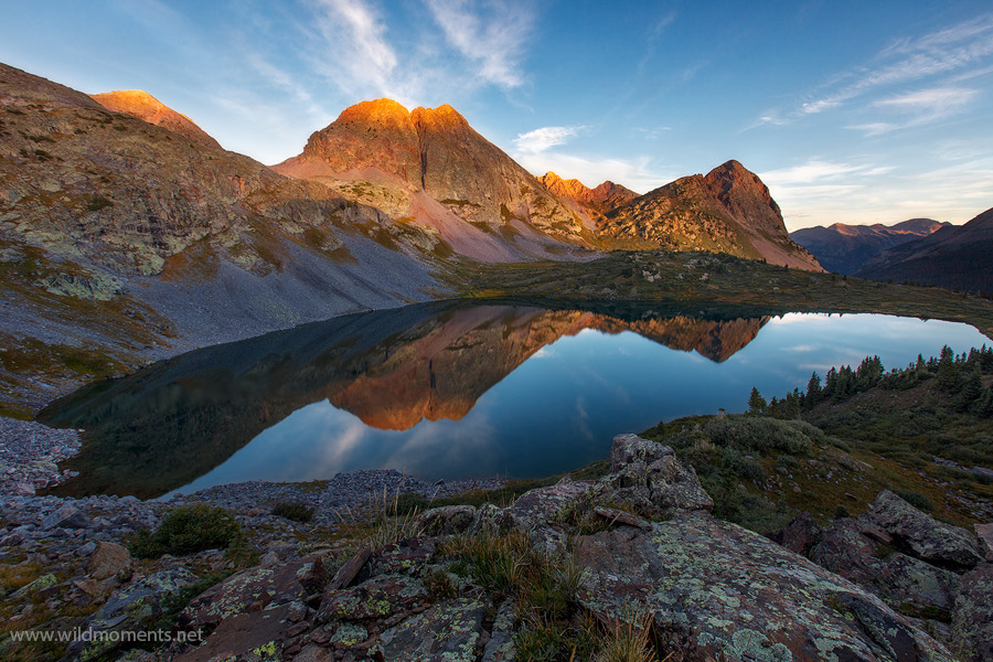 A near fish eyed view of Rock Lake (11,841 ft) captured about 15 minutes after sunrise when...for just a brief moment...a calm...