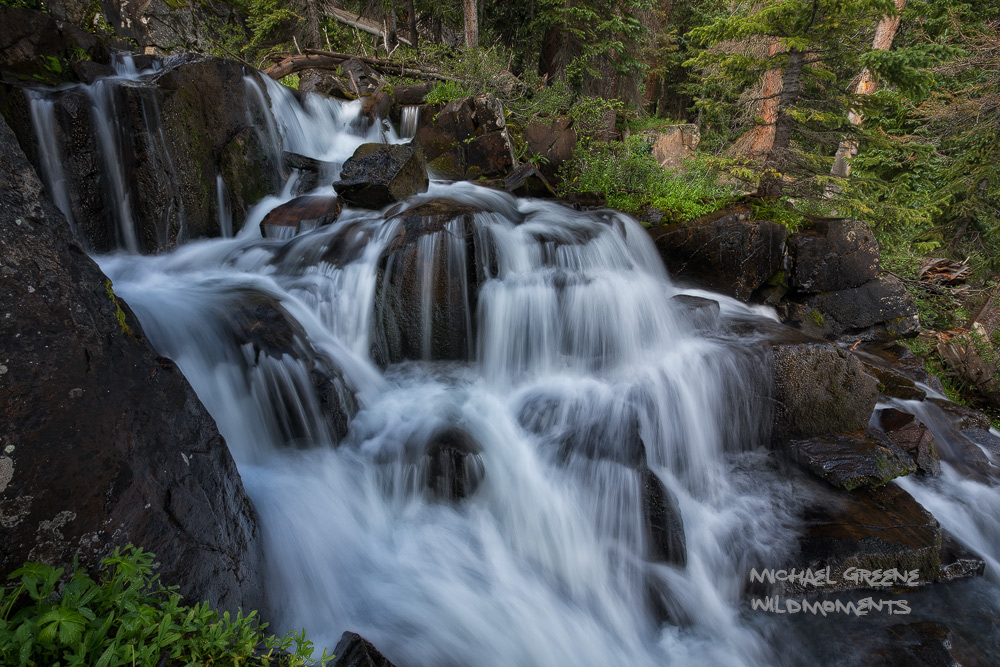 An impressive cascade along the Highland Mary Lakes Trail roars during a rainy summer's morning. This waterfallhike is...