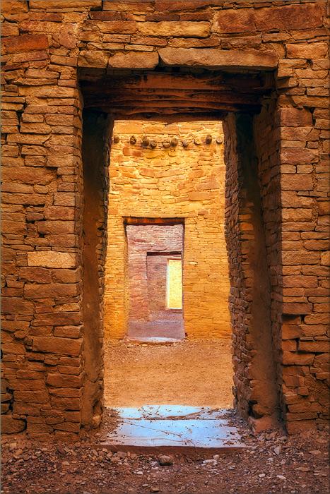 Brilliant light illuminates a deep passage within the complex and ancient structure of Pueblo Bonito in New Mexico.
