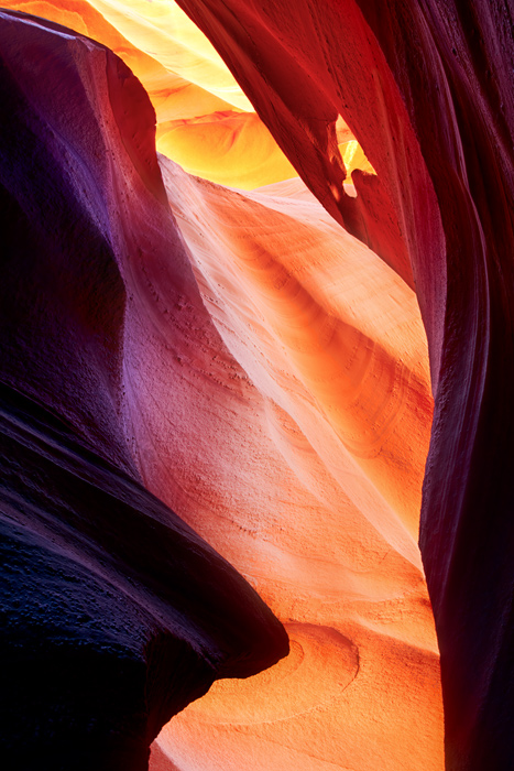 Intense arrays of colors decorate the sandstone walls of Antelope Canyon. Here the small hole in the rock adds texture and character...
