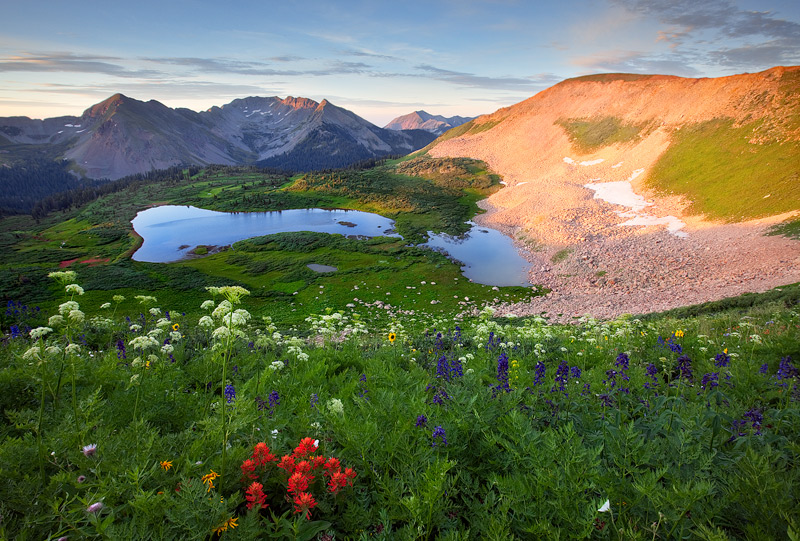 Sunrise in the Taylor Lake Basin near Durango brings magnificent light and color during a banner year for wildflowers.