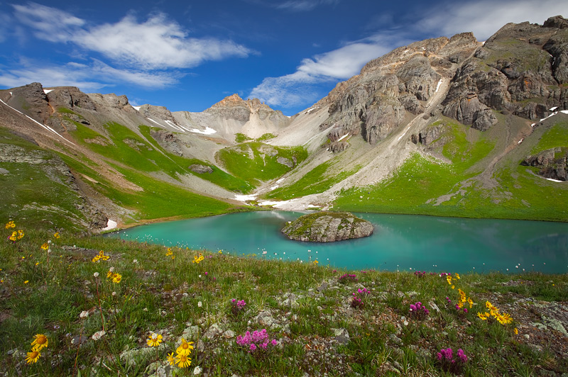 A wildflower laden overlook of picture perfect Island Lake as it shimmers in mid morning light. Located in the background is...