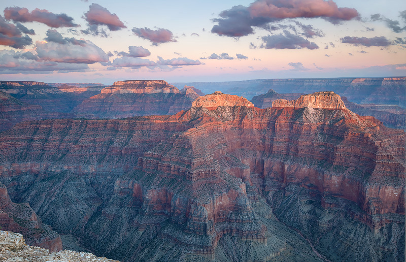 Fast moving clouds are briefly illuminated during the time of last light near Point Sublime at the North Rim, Arizona.