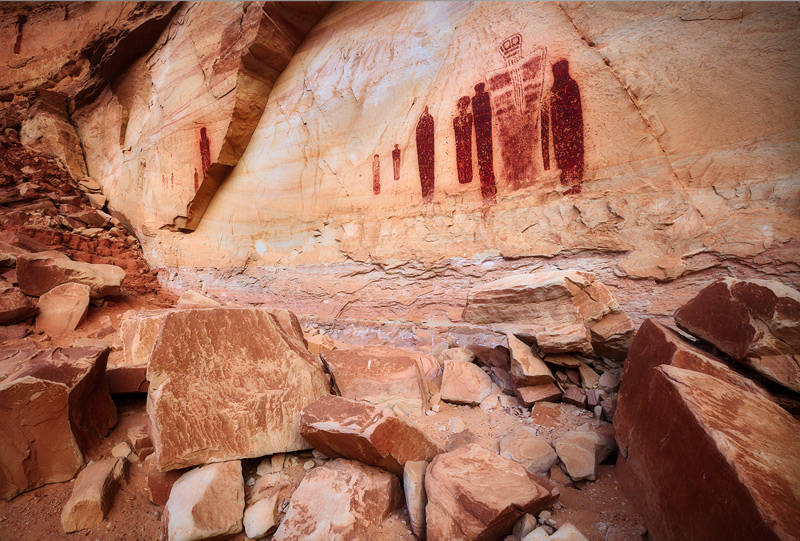 Ancient celestial figures decorate a hidden rock alcove deep in Horseshoe Canyon. These pictographs are estimated to be over...