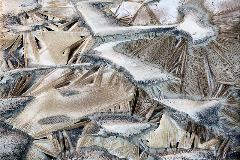 An abstractexamination of a frozen stream of mud, iceand water in the Bisti Badlands of NewMexicoon a...