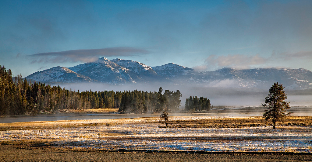 Late September occasionally brings snow to the high meadows of Yellowstone National Park. This view is near Alum Creek with Mount...