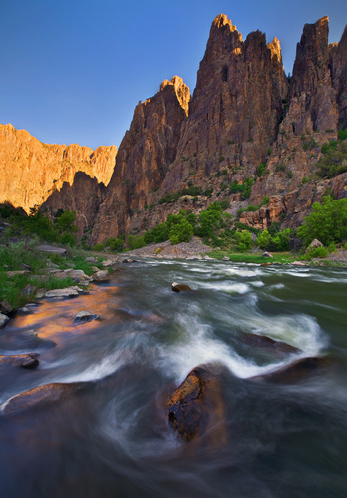 Early morning light trickles down the awe inspiring canyon of Colorado's raging Gunnison River. This image was captured while...