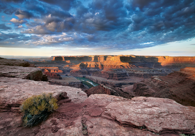 An almost unbelievable scene of clouds and light spill onto the gaping overlook of the meadenering Colorado River near Dead Horse...
