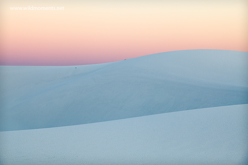 The mirroring and meandering flow of white sands captured at sunset.