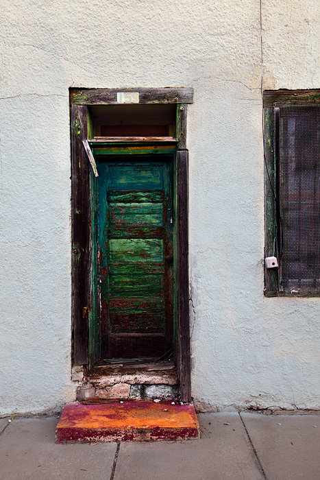 One can only imagine what is behind this cryptic door in Tucson's classic barrio viejo.