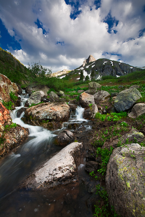 The approaching danger of the summer monsoon season is foreshadowed with fierce skies illuminating a 12,000 foot peak in Colorado...
