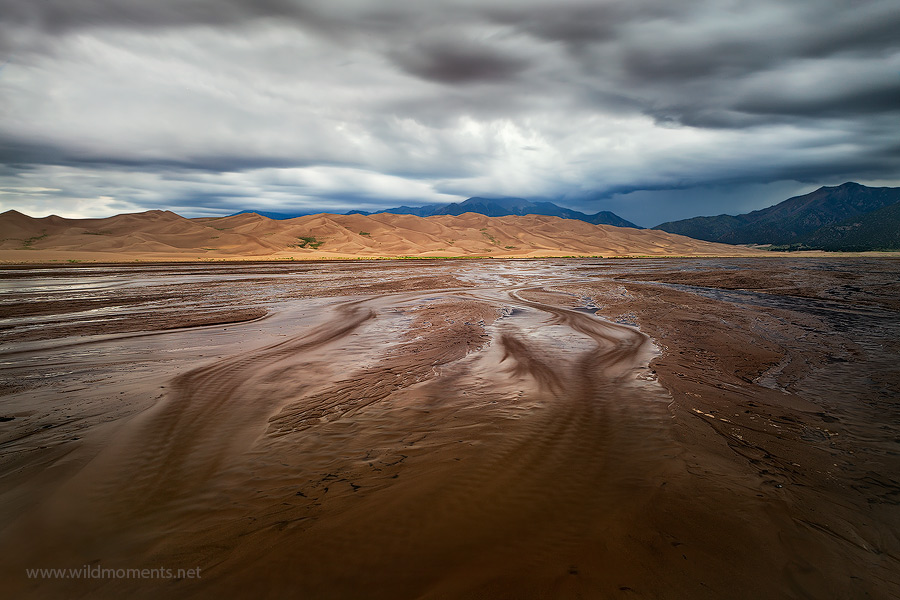 A summer storm forms over the Sangre De Cristo Mountains in Great Sand Dunes NP, CO. Captured using a long exposure from a remote...