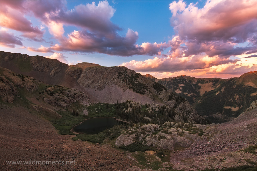 A monsoon inspired sunset over a remote high alpine lake (altitude 11,600 feet) taken from a precipitous vantage point deep in...