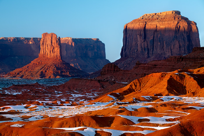 The mixing of snow, red mud, and late afternoon light forms a pleasing abstract in the heart of Monument Valley on the Navajo...
