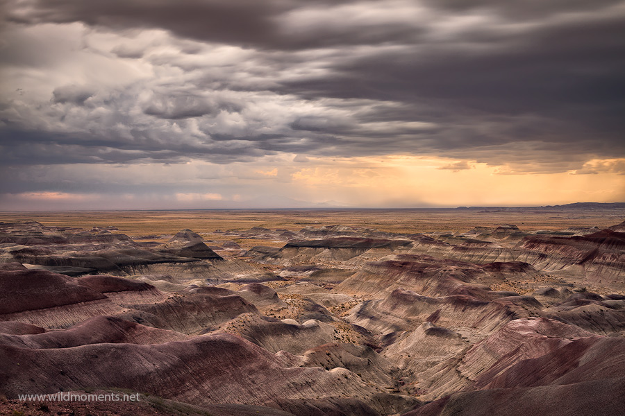 A long exposure adds to the intrigue of a distant storm captured from a remote perch in the painted desert near Winslow, AZ.