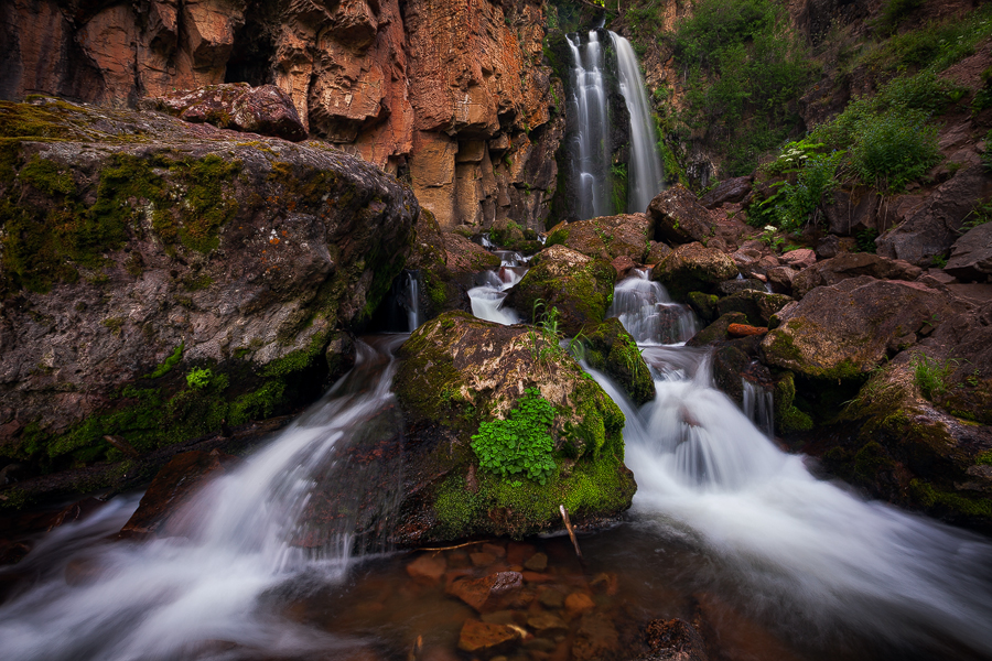 Remote Rough Creek Falls is located in the heart of the South San Juan Wilderness. The falls are found in a sandstone ravine...