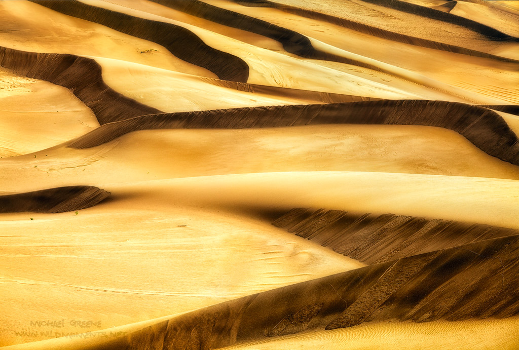 I used a telephoto lens to compress the sand patterns of the front dunes in Great Sand Dunes NP while exploring during summer...