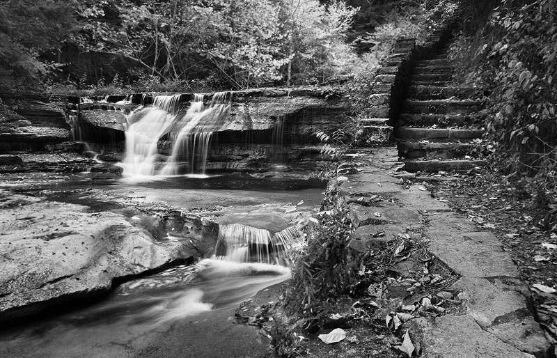 Stillness sets in as moments leading up to a storm come to pass during a cloudy, fall afternoon.The stonefootpath...