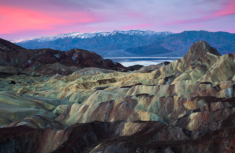 The pastel colors of dawn illuminate the surreal,rolling badlands near Manly Beacon &Zabriskie Point in Death...